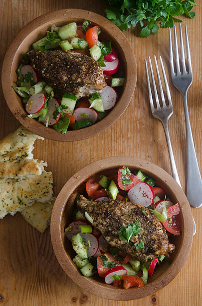 Za'atar chicken with fattoush Za'atar spiced chicken breast with fattoush salad zaatar spice stock pictures, royalty-free photos & images