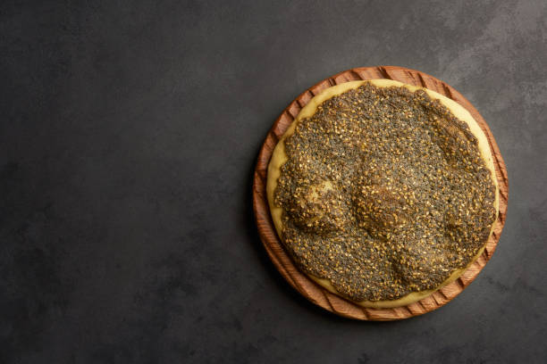 Zaatar manakeesh on black stone background  . Top view with copy space Food, Arabic cuisine, Zaatar, Breakfast zaatar spice stock pictures, royalty-free photos & images