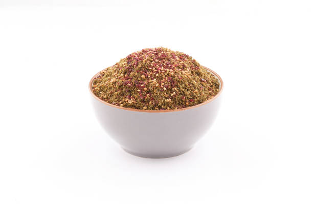 zaatar mIddle eastern spices in a bowl on white  background organic zaatar with toasted sesame mIddle eastern spices in a bowl isolated on white  background zaatar spice stock pictures, royalty-free photos & images