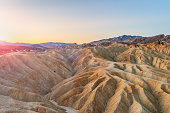 Beautiful landscape of mudstone badlands at Zabriskie Point at sunrise in summer, Death Valley National Park, California, USA.