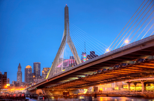 Zakim Bridge over the Charles River at dusk. The Leonard P. Zakim Bunker Hill Bridge, is a cable-stayed bridge across the Charles River and was part of the Big Dig Project in Boston. The Big Dig, was the largest highway construction project in the United States. The Zakim Bridge is the widest cable-stayed bridge in the world.