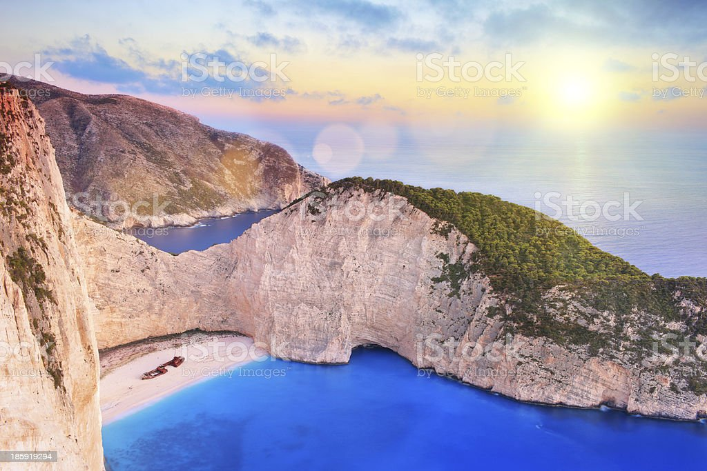 Zakynthos island with shipwreck on beach, at sunset stock photo