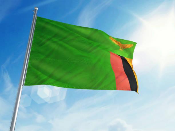 sambia-flagge auf einem cloud-hintergrund - sambia stock-fotos und bilder