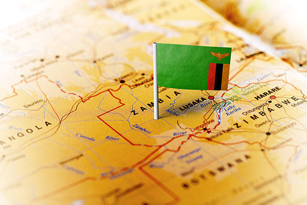 zambia pinned on the map with flag - sambia stock-fotos und bilder
