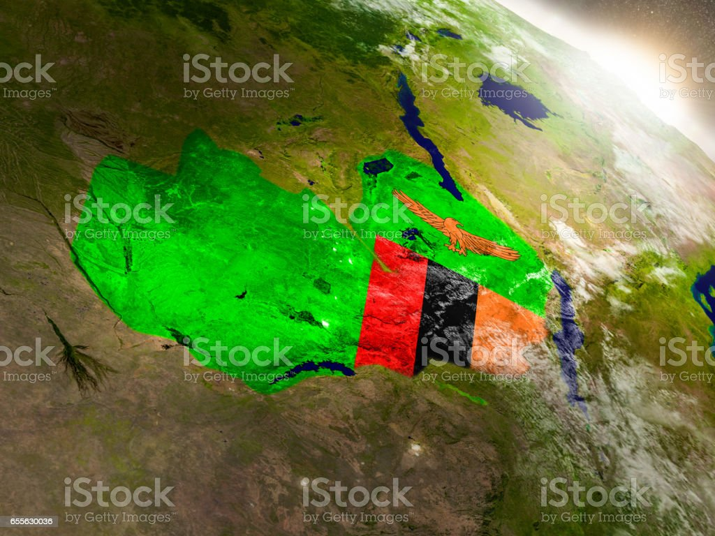 Zambia with flag in rising sun stock photo