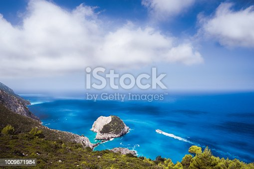 istock Zante fantastic coastal view with white cliff and azure sea water. White tourist ship sailing full speed on open water 1009671984