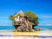 istock Zanzibar May 2016, The rock restaurant Zanzibar ,Over water house build in a coral rock in Zanzibar 1214486891
