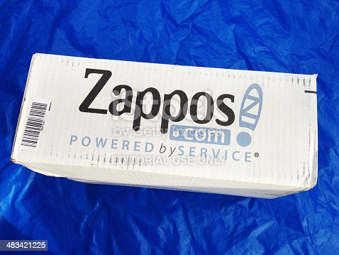 West Palm Beach, USA - January 3, 2014: Zappos.com merchandise delivery package. Zappos.com is an on line shoe and clothing retail store. It was acquired by Amazon.com in 2009.