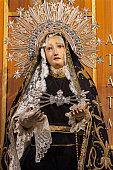 Zaragoza - The detail of typically vested, cried Virgin Mary statue in church Iglesia del Perpetuo Socorro