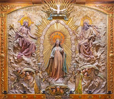 Zaragoza - The polychome carved relief of Coronation of Virgin Mary in church  Basílica de Santa Engracia from, 19. cent.