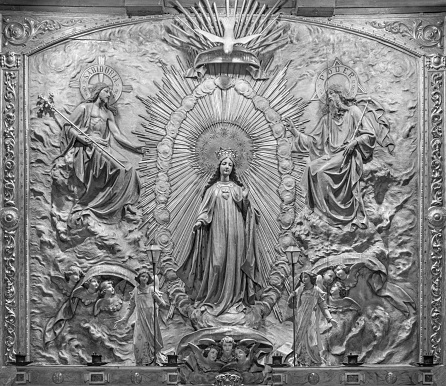 Zaragoza - The polychome carved relief of Coronation of Virgin Mary in church  Basílica de Santa Engracia from 19. cent.