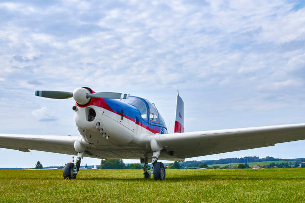 Zbraslavice / Czechia - 08/25/2019: Front view of Zlin Z-43 four-seat airplane standing on a grass runway.  Low-wing monoplane. stock photo