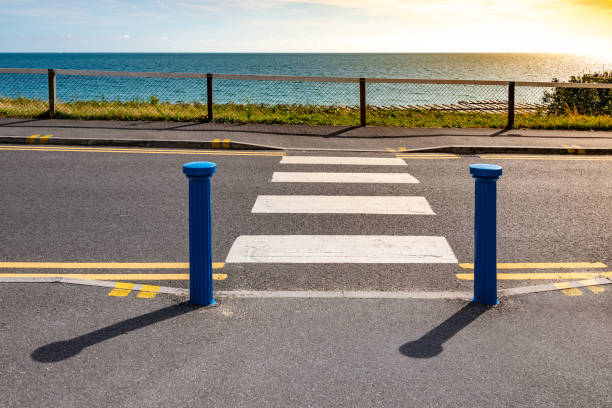 Zebra crossing leading to the beach stock photo