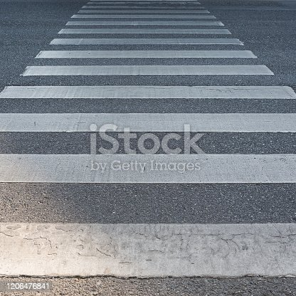 Zebra crosswalk in close up view on road at Thailand.