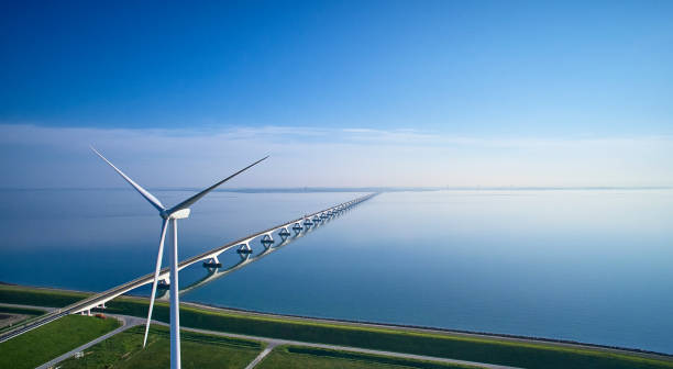 Zeeland Bridge aerial with wind turbine stock photo