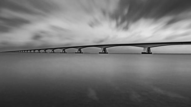 Zeeland bridge at dawn in black and white stock photo