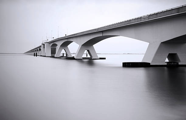 Zeeland Bridge in long exposure  desaturated stock pictures, royalty-free photos & images