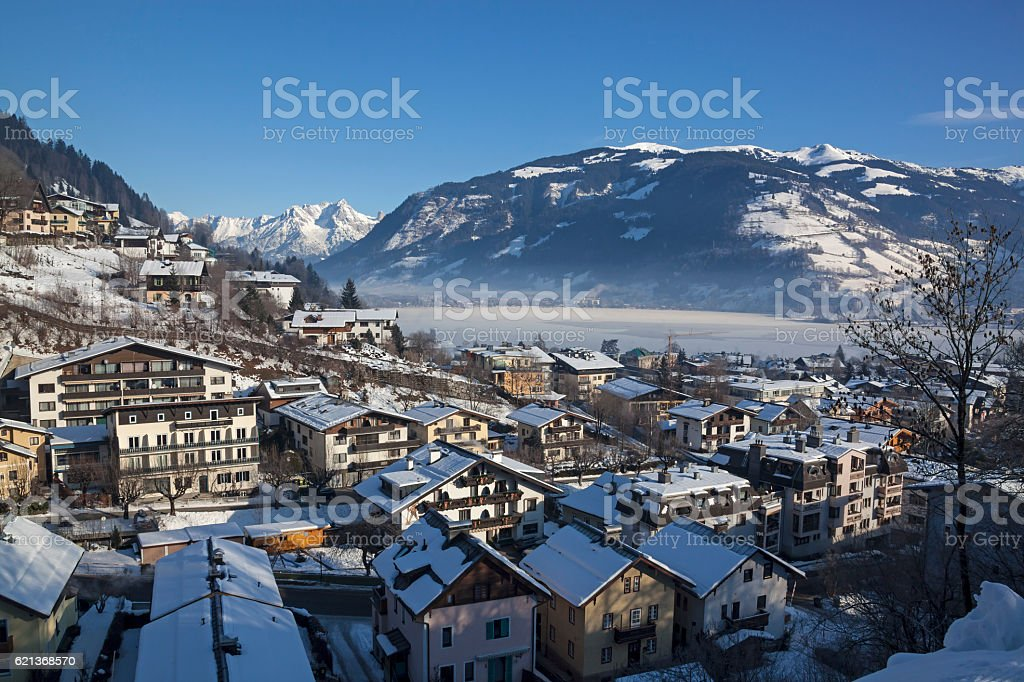 Zell am See town over the Zell lake and Alps stock photo