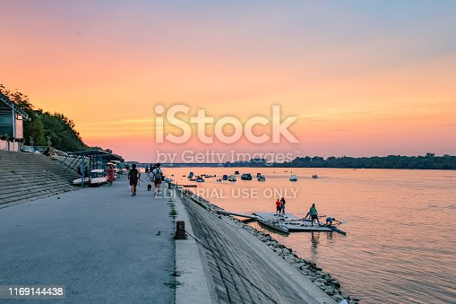 Belgrade, Serbia - August 13, 2019 - Zemun quay (Zemunski kej)  coastline sunset landscape with people and boats parked on on river Danube