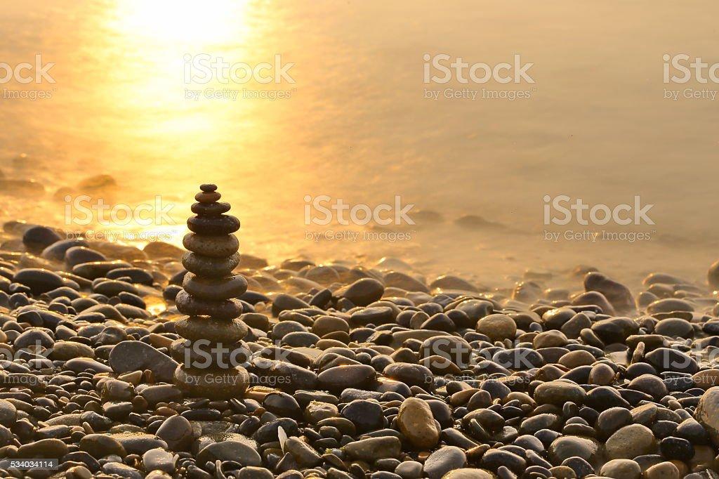 Zen balance rocks pebbles by the sea stock photo