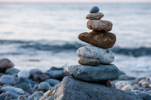 zen balancing pebbles, harmony and balance - stack rock stock pictures, royalty-free photos & images