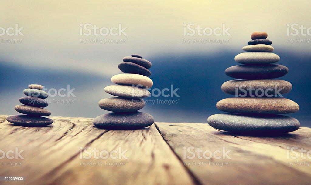 Zen Balancing Pebbles Next to a Misty Lake Concept Zen Balancing Pebbles Next to a Misty Lake Concept Aspirations Stock Photo