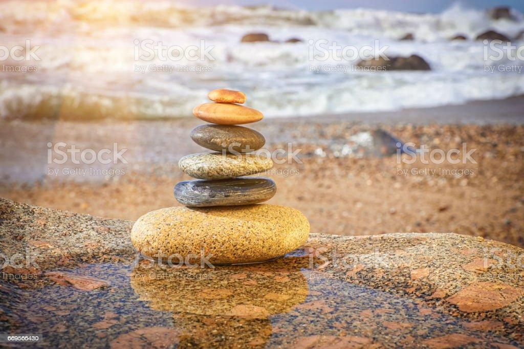 Zen Balancing Pebbles on Beach stock photo