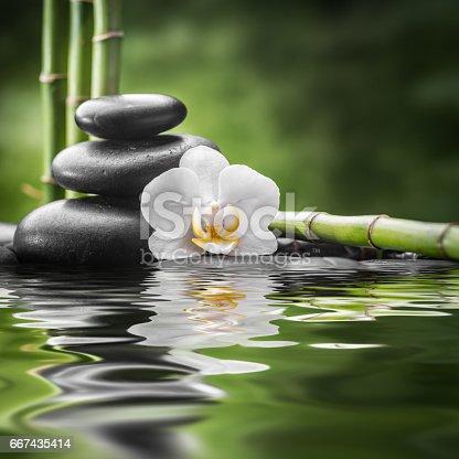 istock zen basalt stones and bamboo 667435414
