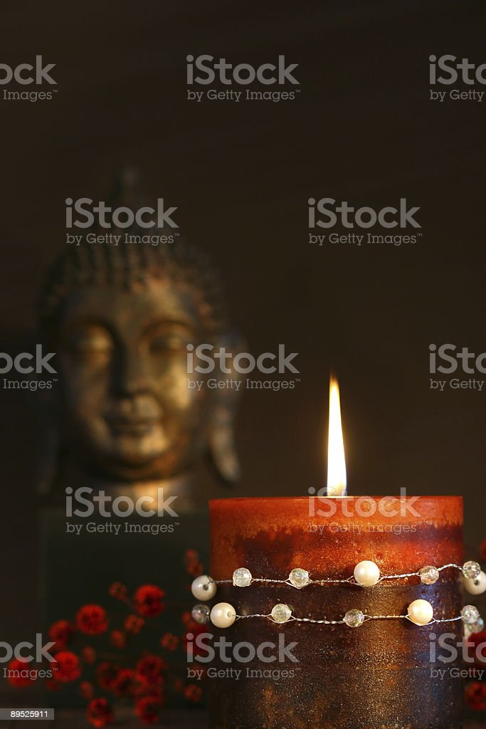 Zen candle and buddha statue royalty-free stock photo