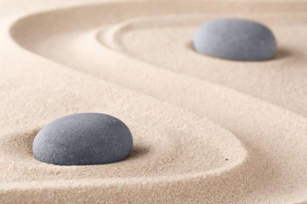 Zen garden meditation stone Zen garden meditation stone. Round rock on sandy texture background. Yoga or mindfulness concept. spa belgium stock pictures, royalty-free photos & images