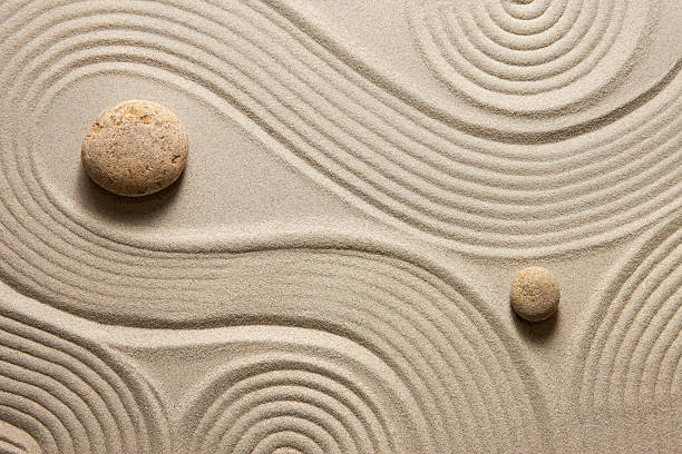 Zen garden Top view of raked sand with stones tranquil scene stock pictures, royalty-free photos & images