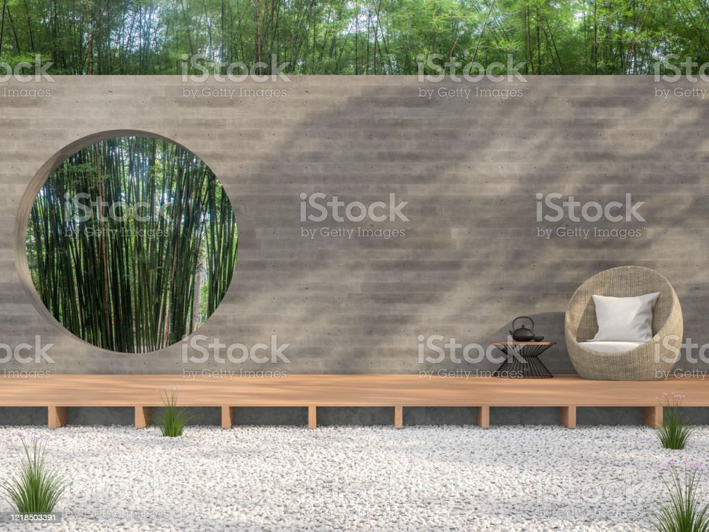 Zen garden style idea 3d render Zen garden style idea 3d render,There are white stone ground,wooden terrace,blank concrete wall with circle shape of void overlooking bamboo garden background. Architecture Stock Photo