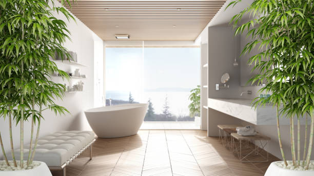 Zen interior with potted bamboo plant, natural interior design concept, minimalist luxury bathroom with bathtub, shower and window, contemporary modern architecture concept idea stock photo
