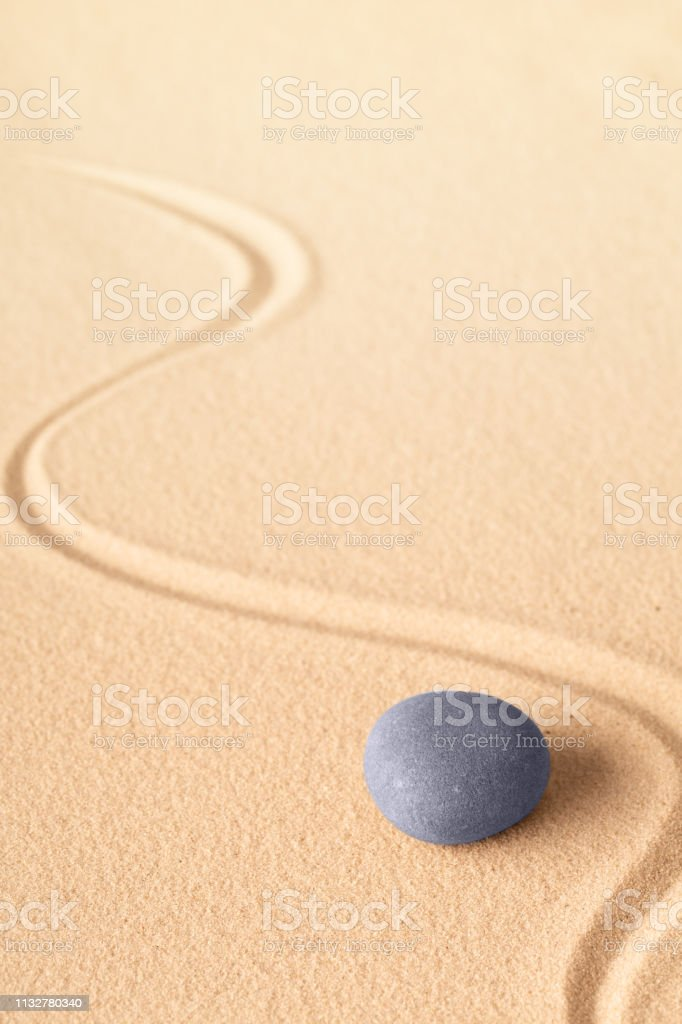 zen meditation or yoga background with blue round stone for focus and concentration stock photo