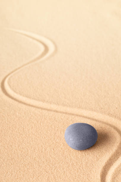 zen meditation or yoga background with blue round stone for focus and concentration - spa belgium stock photos and pictures