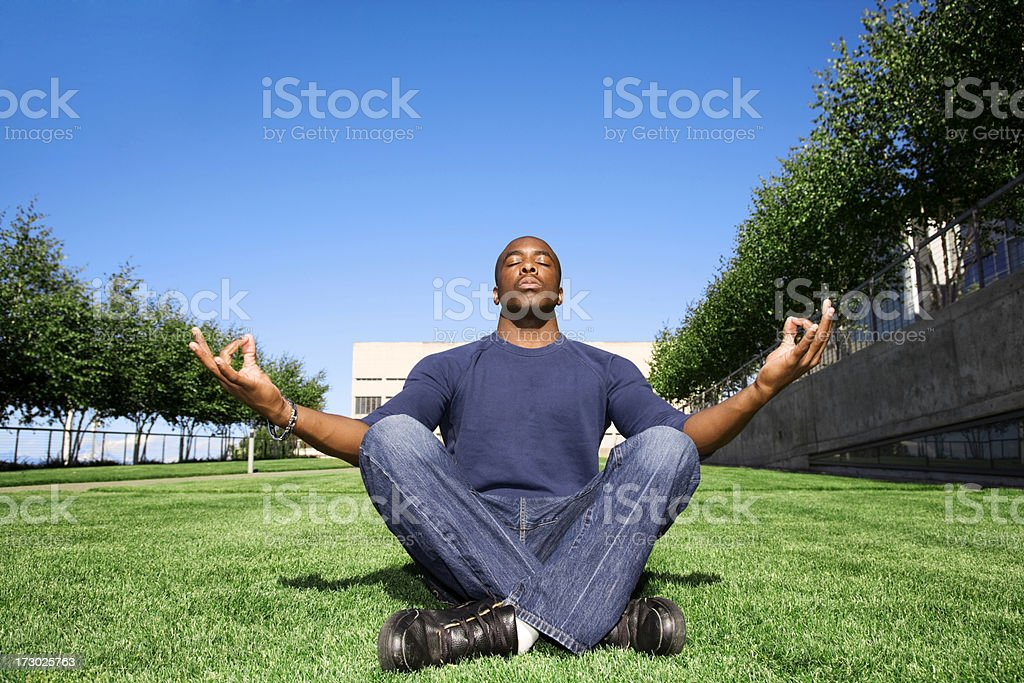 Zen Meditation stress free day male african american student royalty-free stock photo