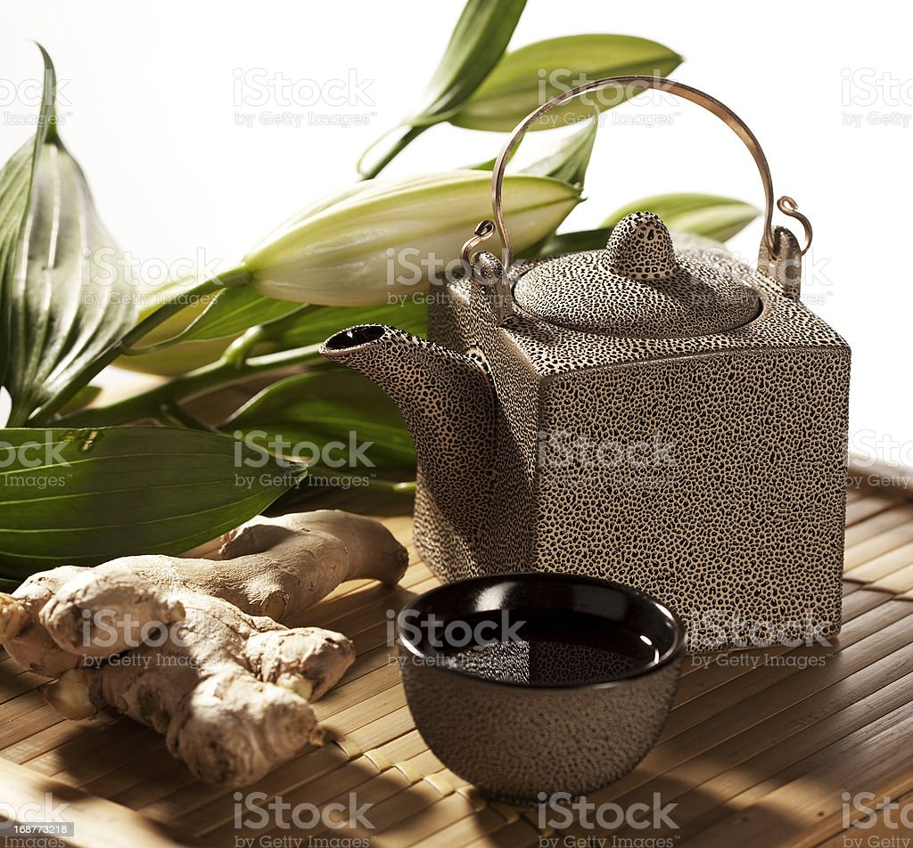 Zen photograph of a oriental tea cup and tea pot with ginger royalty-free stock photo