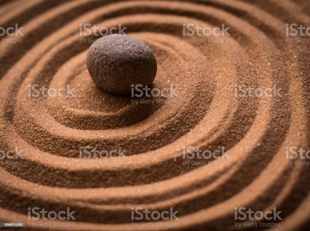 Zen Rock in the Sand stock photo