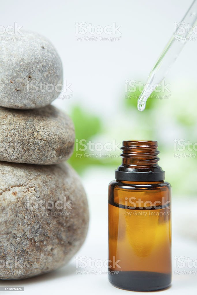 Zen rocks and essential oil stock photo