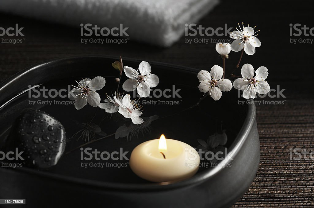 Zen Spa with Floating Candle and Blossoms stock photo