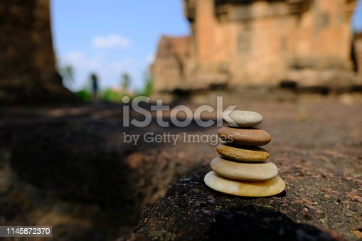 istock Zen stone at the ancient Cambodian ruins castle 1145872370