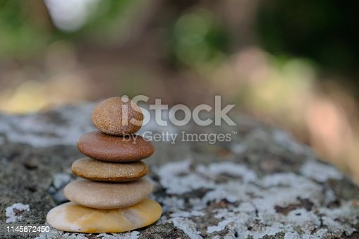 istock Zen stone at the ancient Cambodian ruins castle 1145872450