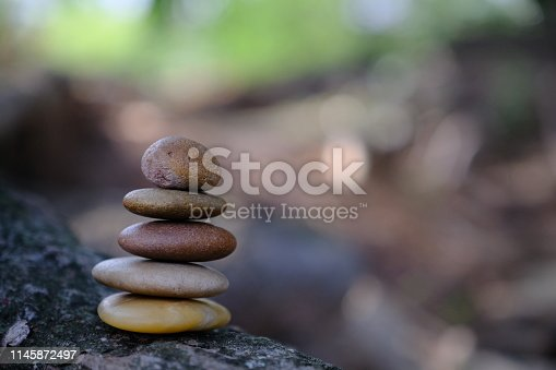 istock Zen stone at the ancient Cambodian ruins castle 1145872497