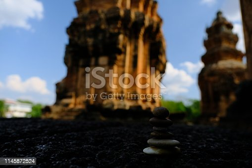 186803914 istock photo Zen stone at the ancient Cambodian ruins castle 1145872524