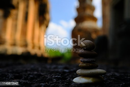 istock Zen stone at the ancient Cambodian ruins castle 1145872542