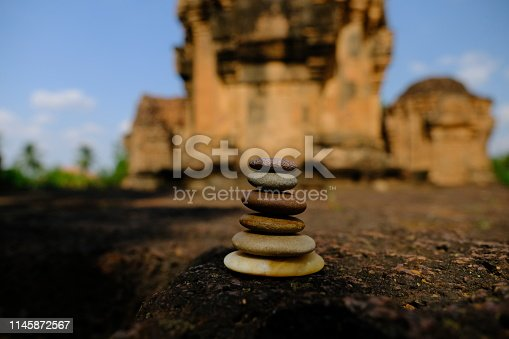 istock Zen stone at the ancient Cambodian ruins castle 1145872567