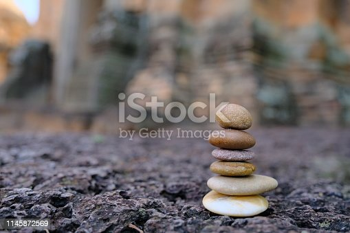 istock Zen stone at the ancient Cambodian ruins castle 1145872569