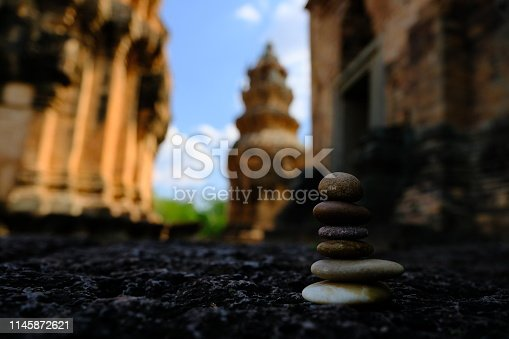 186803914 istock photo Zen stone at the ancient Cambodian ruins castle 1145872621