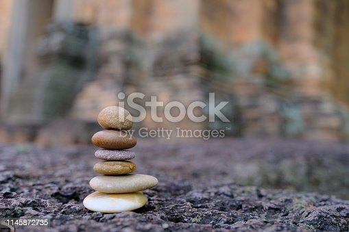 istock Zen stone at the ancient Cambodian ruins castle 1145872735