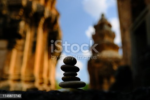 istock Zen stone at the ancient Cambodian ruins castle 1145872740